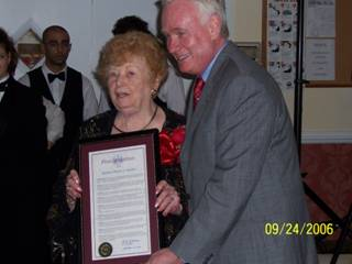 1. Honoring New Utrecht Reformed Church member Rose Giannini Lood on her 90th birthday, State senator Martin J. Golden presents her with a proclamation during a party at Bay Ridge Manor.