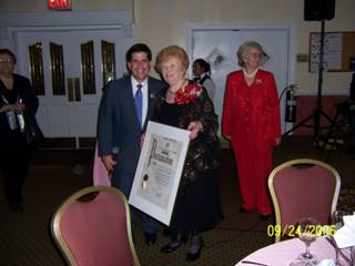 2. City Council member Vincent J. Gentile presents a Council proclamation to Rose Giannini Lood, longtime New Utrecht Reforned Church member and community leader, on her 90th birthday at a party at Bay Ridge Manor. Mrs. Lood's daughter, Susan Hanyen, stands nearby.