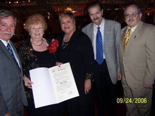 3. State Assemblyman Peter J. Abbate, Jr., presents Rose Giannini Lood with a proclamation noting her 90th birthday. Left to right: Abbate, Mrs. Lood, District leader Delia Schack, Robert Buonovino and Supreme Court Justice Arthur M. Schack.