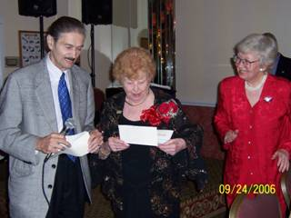 4. Robert Buonvino, President of Friends of Historic New Utrecht, presents a $21,000 check to Rose Giannini Lood to be used toward restoration of the New Utrecht Reformed Church. Mrs. Lood, at her 90th birthday celebration at Bay Ridge Manor, asked that anyone giving gifts put them toward restoring the historic church sanctuary.