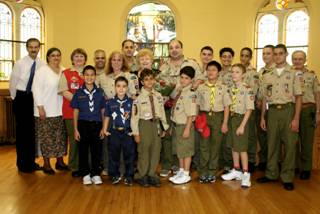 5.Cub Scouts, Boy Scouts of Troop 20, the country's oldest troop, are among those who celebrated the 90th birthday of church member and community leader Rose Giannini Rose (Center) in the Parish House of the New Utrecht Reformed Church, near the historic sanctuary where an extensive $2 million repair and restoration is under way.